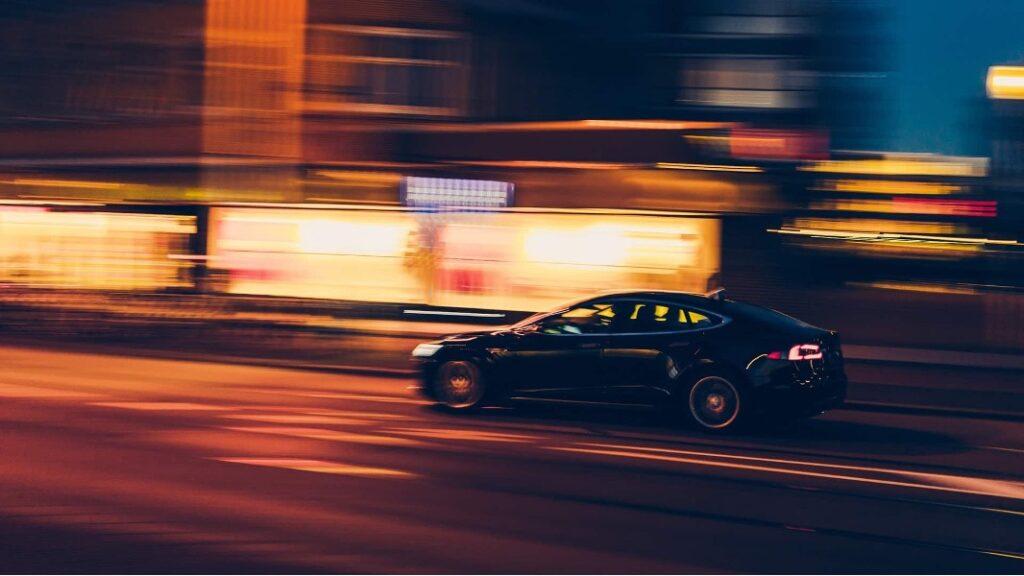 An electric car speeding through the city
